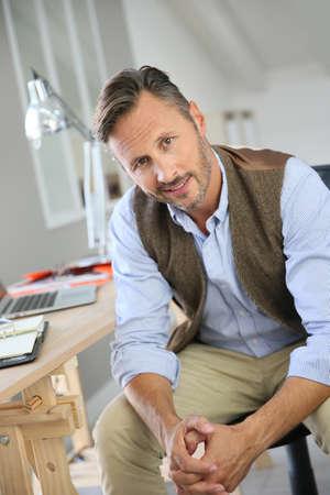 telework: Handsome man sitting in office