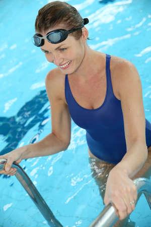 swimming: Beautiful woman in public indoor swimming pool