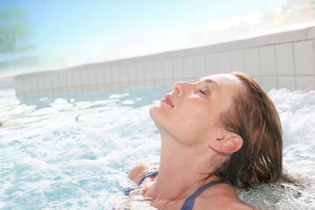 spa woman: Beautiful woman relaxing in hot tub of spa center pool
