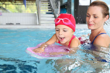 Mother and daughter training at the swimming-pool Stock Photo