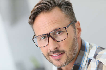 mature man: Portrait of handsome 40-year-old man with eyeglasses