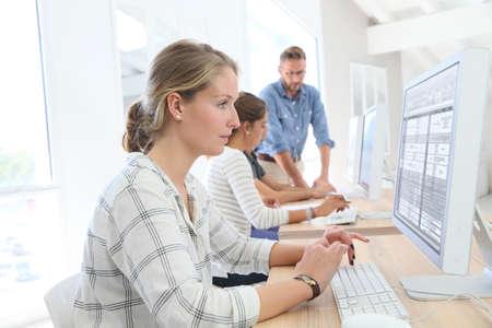 computer desk: Student girl in class sitting in front of desktop computer