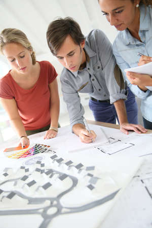 workteam: Students in architecture working on project Stock Photo