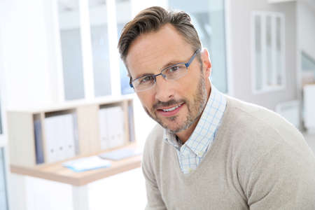 Portrait of handsome middle-aged man with eyeglasses