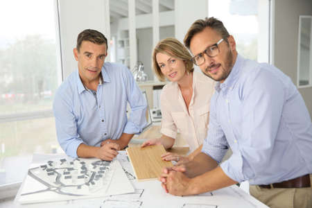 architect: Team of architects meeting in office Stock Photo