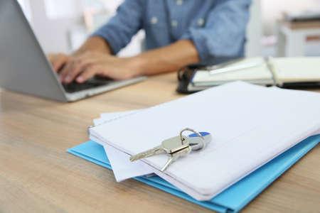 home loan: Closeup of house keys set on notebook