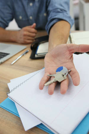 home loan: Real estate agent giving keys to property owner