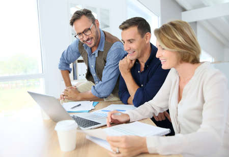 collaboration: Financial department people working on budget plan Stock Photo