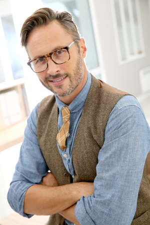 fourties: Portrait of handsome stylish guy with eyeglasses