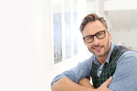 man style: Portrait of confident handsome man with eyeglasses