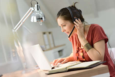 telework: Woman telemarking assistant working from home Stock Photo