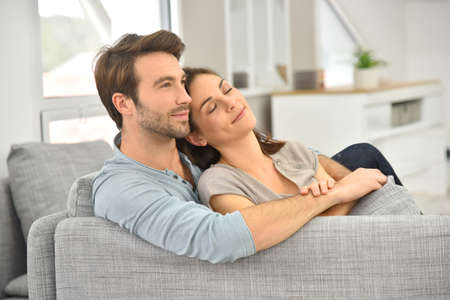 couple relaxing: Young couple relaxing in sofa Stock Photo
