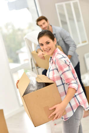 moving: Young couple moving into new home