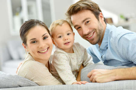 family with baby: Portrait of happy young couple with baby girl
