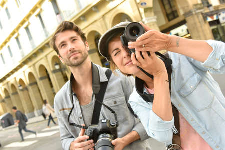 newsman: Young people doing a photo reportage in town