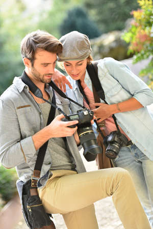 reportage: Team of young photographers doing a photo reportage Stock Photo