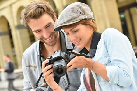reportage: Young people doing a photo reportage in town