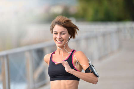 athletic girl: Cheerful athletic girl running outside