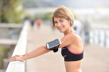sport woman: Woman stretching out after running Stock Photo