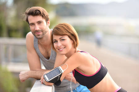outdoor fitness: Athletic couple stretching out after running