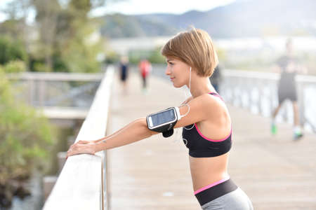woman outdoor: Woman stretching out after running Stock Photo