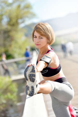 woman stretching: Woman stretching out after running Stock Photo