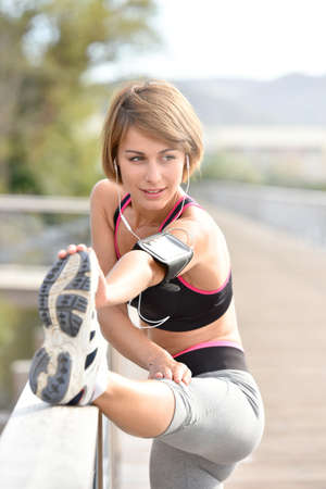 mooie vrouwen: Woman stretching out after running Stockfoto