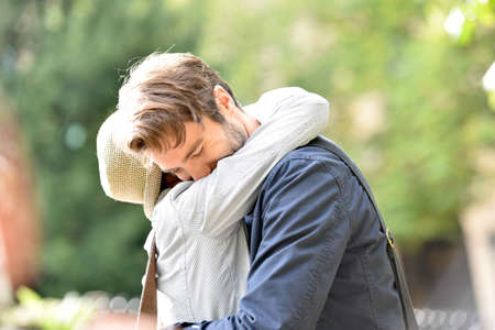 2 years old: Romantic young couple embracing in park, sunlight Stock Photo