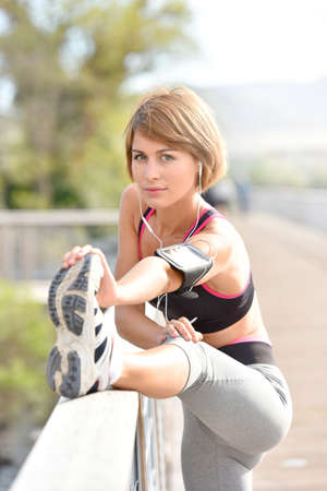 stretch out: Woman stretching out after running Stock Photo