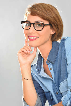 25 years old: Portrait of young woman wearing eyeglasses, isolated