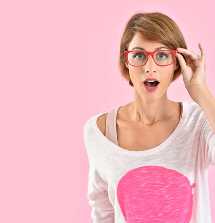 casual fashion: Trendy girl with eyeglasses, surprised look Stock Photo