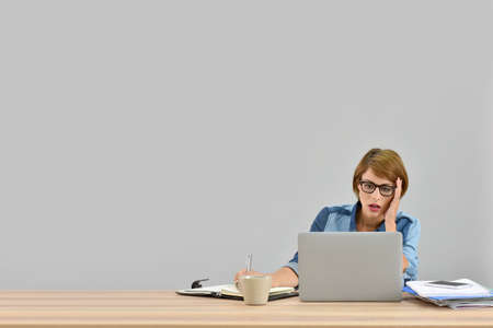 Busy office worker in front of laptop, isolated