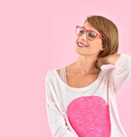 lady in red: Portrait of trendy girl with red glasses, pink background