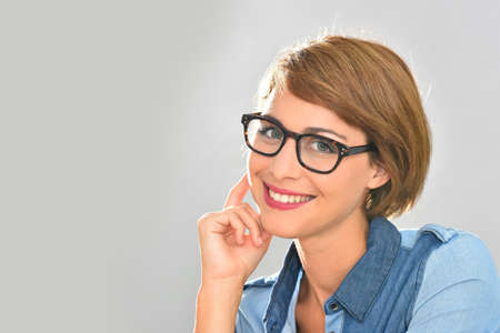 casual attire: Portrait of young woman wearing eyeglasses, isolated