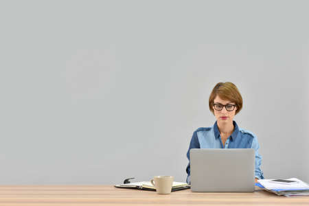 officeworker: Businesswoman working on laptop, isolated