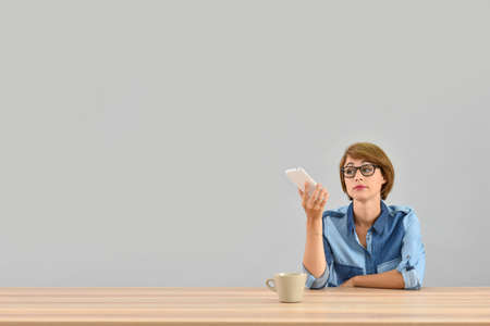 woman on phone: Young woman being annoyed with conversation on the phone
