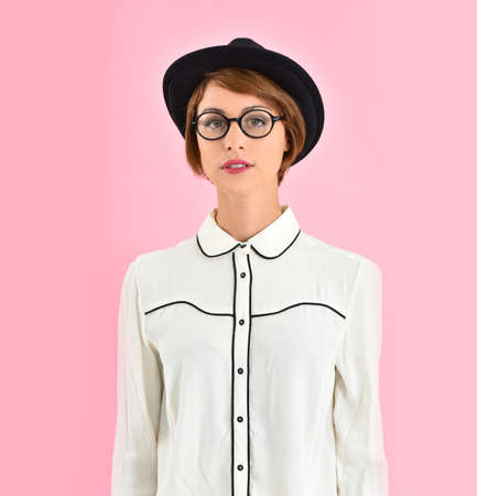 girl in a hat: Portrait of trendy girl wearing black hat and eyeglasses Stock Photo