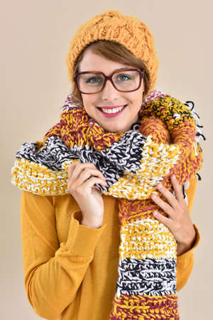 yellow fleece: Portrait of trendy girl with eyeglasses and winter accessories Stock Photo