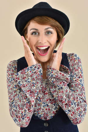 25 years old: Portrait of stylish girl with surprised looked, isolated Stock Photo