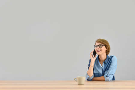 officeworker: Young woman talking on the phone, isolated