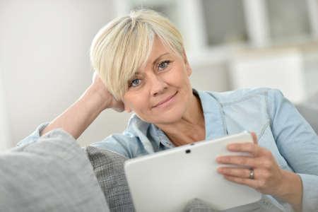 websurfing: Senior woman websurfing on digital tablet