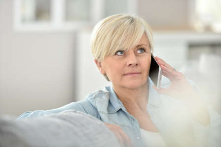 senior women: Closeup of senior woman talking on phone Stock Photo