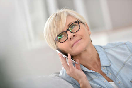 woman  glasses: Senior woman talking on mobile phone