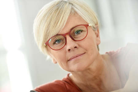 one woman: Portrait of smiling senior woman with eyeglasses