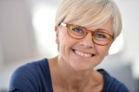 Portrait of smiling senior woman with eyeglasses
