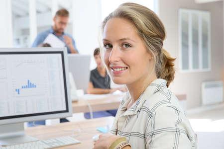 person computer: Portrait of student girl working on desktop computer