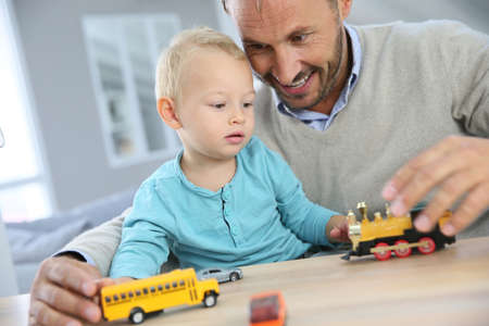 toy cars: Daddy with baby playing with toy cars