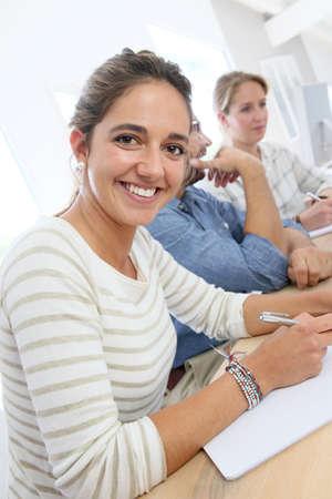 workteam: Portrait of smiling brunette school girl in class