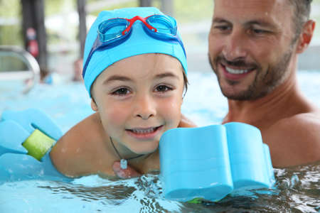 class a: Little boy learning how to swim Stock Photo