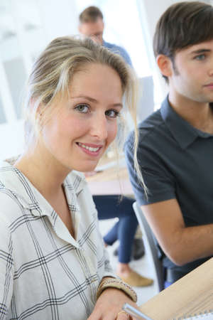 schoolmate: Portrait of smiling student girl working with classmate Stock Photo